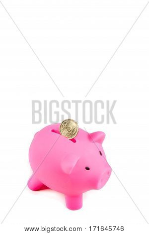 Piggybank with twenty Euro cent coin and copy space