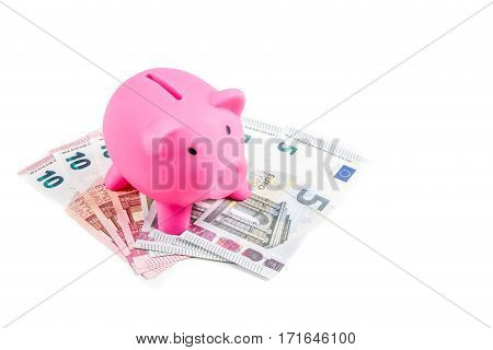 Piggybank with five and ten Euro banknotes