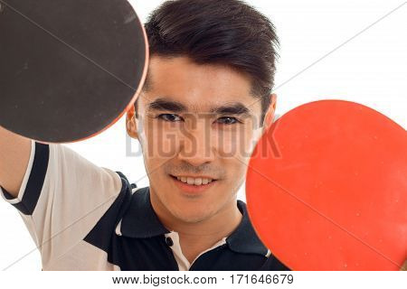 handsome brunette sports man practicing ping-ping isolated on white