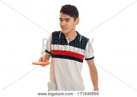 serious brunette sports man practicing ping-ping isolated on white