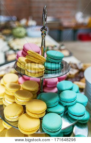 pink yellow and blue macarons on table