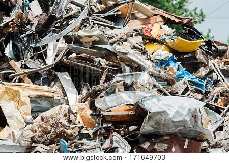 Metal scrap pile in scrap yard ready for recycling