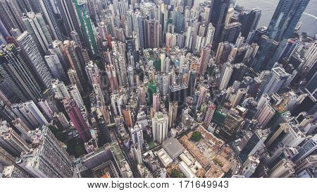 Aerial photo from flying drone of an amazing landscape on a China city with modern skyscrapers and enterprises. Top view on a developed Hong Kong town with office buildings and advanced infrastructure