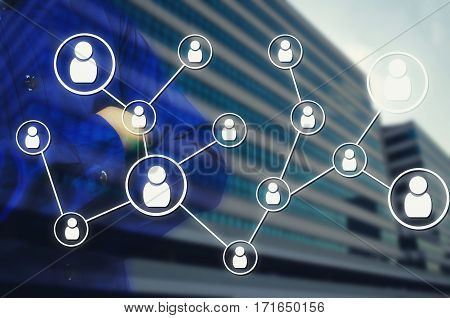 Double exposure of man arms crossed and icon social media connection concept with blurred background of office building, color tone effect.
