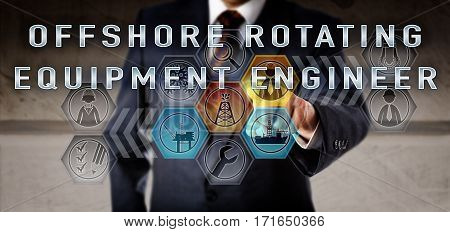 Male recruitment manager in blue business suit is activating OFFSHORE ROTATING EQUIPMENT ENGINEER. Oil and gas industrial job concept for a mechanical engineering or technical authority position.