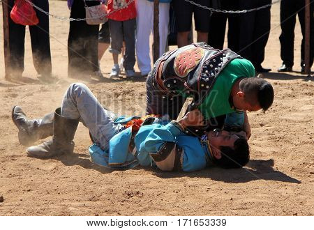 Inner Mongolia, China - July 14: The Mongolian Young Men Wrestling In The In The Steppe Near Hohhot