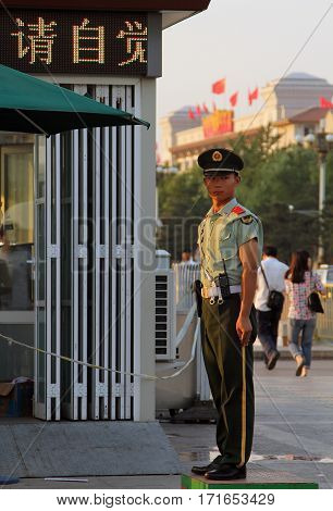 Beijing - July 3: A Soldier Stands Guard At The Entrance To The Tiananmen Square In Beijing, China