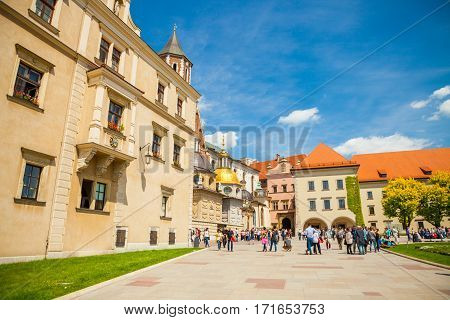 Krakow, Poland - May 16, 2015: Tourists Heading Towards Historical Complex Of Wawel Royal Castle And