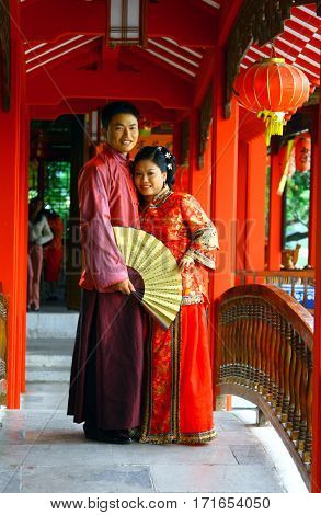 Guilin, China - Nov 4, 2007: Young Couple In Traditional Chinese Costumes. Red Is The Main Color Of