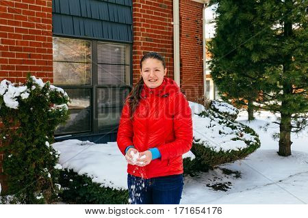 Beautiful Young Smiling Happily As She Walks Through Wintery