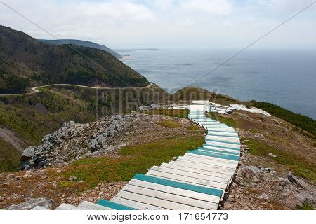Boardwalk at the seaside and mountain highway along the ocean