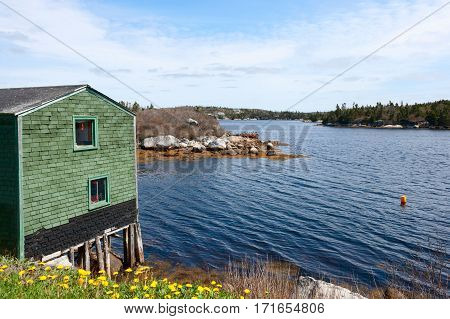 Small house above the water in Peggy's Cove