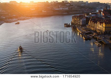 Douro River at sunset, view from the bridge Dom Luis I, Porto, Portugal.