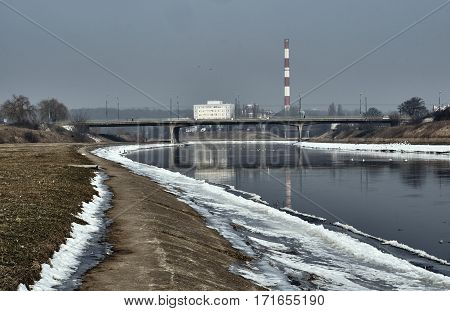 Bridge on the River worth during the winter in Poznan