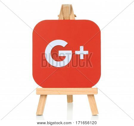 Kiev Ukraine - August 30 2016: Google Plus logo printed on paper and placed on wooden easel. Google is a well-known social networking service