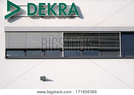 MAINZ, GERMANY - FEBRUARY 14: The facade and roof edge of the vehicle testing center Dekra with logo on February 14 2017 in Mainz.