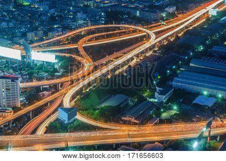 Bangkok skyline at nigh cityscape with car light tail Thailand