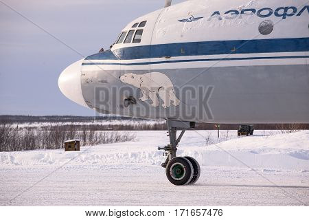 Severomorsk, Murmansk Region, Russia - February 28, 2012: Routine busy day at the airbase. Flying of  Il-20rt (is a large turboprop airliner that first flew in 1957 and became one of the best known and durable Soviet aircraft of its era. )