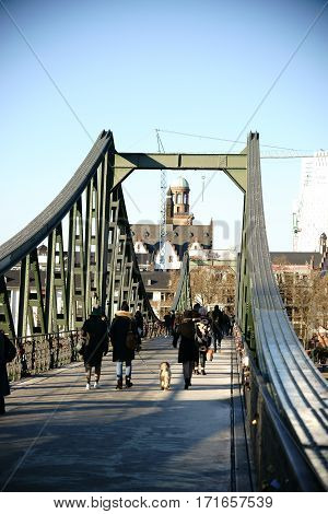 FRANKFURT, GERMANY - JANUARY 05: Visitors crossing the Iron Bridge in direction to the the old town and the Roman Mountain on January 05, 2017 in Frankfurt.