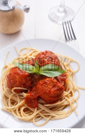 Vegan chickpea meatballs with tomato sauce and spaghetti
