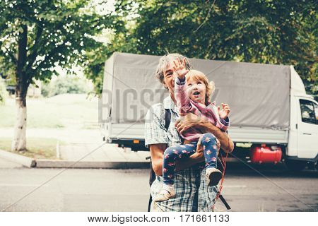 The family father and daughter outdoors. The concept of happiness prosperity.