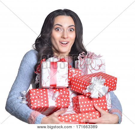 young woman holding pile of present boxes