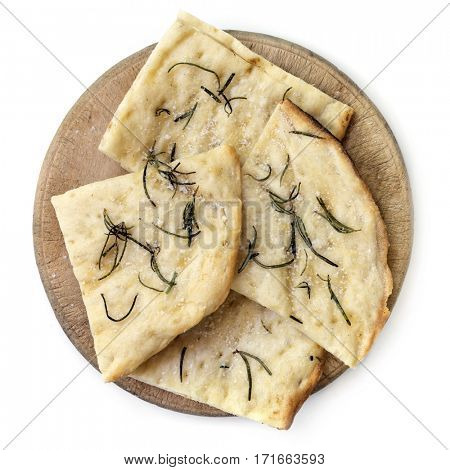 Crispy flatbread with rosemary and sea salt on old board.  Top view, isolated on white.