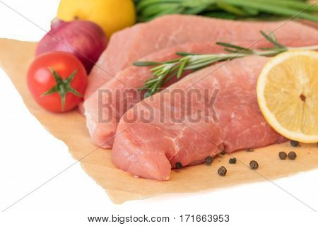 Sliced Pork With Vegetables And Spices On Paper.