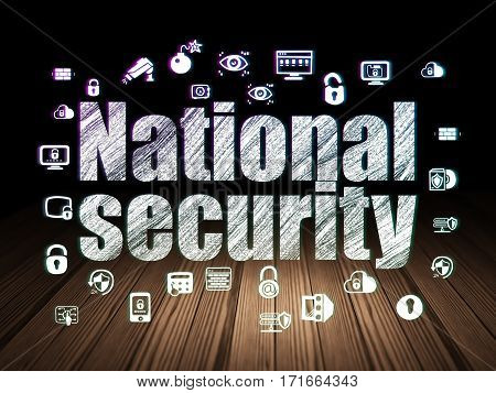 Security concept: Glowing text National Security,  Hand Drawn Security Icons in grunge dark room with Wooden Floor, black background