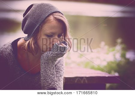 Lonely sad teen girl portrait at the nature