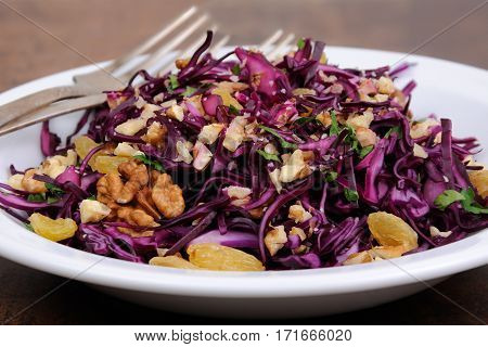 salad red coleslaw with raisins and crushed walnut