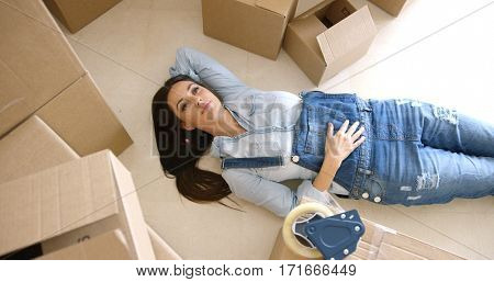 Attractive young woman relaxing on the floor