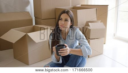 Thoughtful young woman contemplating her new house