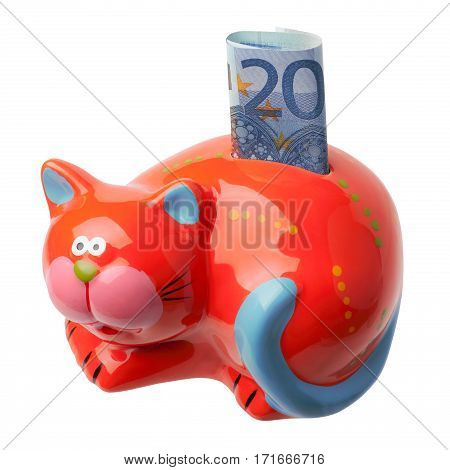 Red piggy bank in the form of a cat with an inserted banknote in 20 euros. Piggybank is isolated on white background