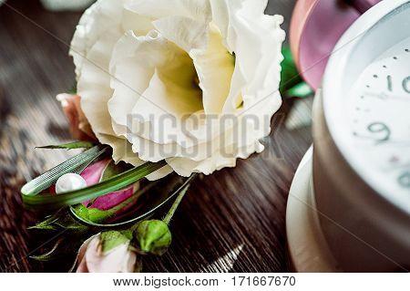 Macro Of Wedding Flowersnext To Romantic Clock