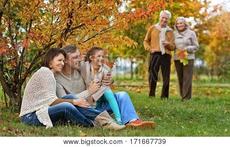 Portrait of a big family on picnic in autumn