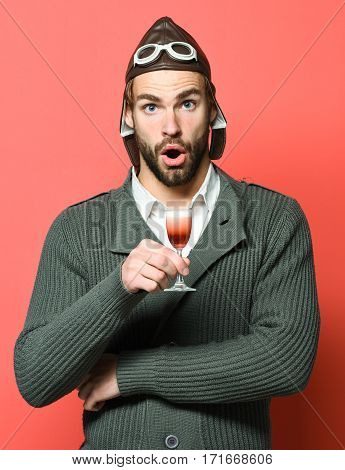 Bearded Pilot With Cocktail In Glass