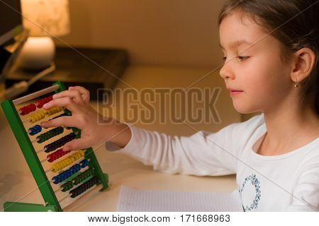 Little girl learning numbers at home  close up