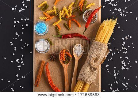 Bunch Of Spaghetti And Colorful Fusilli On Corkboard