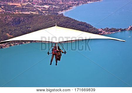 Hanggliding over Lac Annecy, France. Town of Annecy in the far distance. Town of Talloires on middle right.