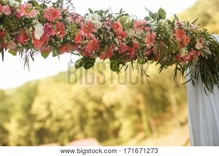 The wedding archway with pink and white flowers