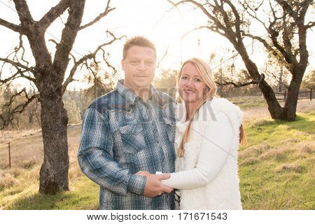 Beautiful Young Happy Couple Standing Together Outside