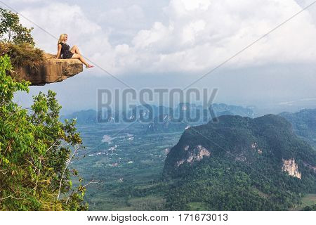 Girl Sitting At The Stone Rock. Picturesque Observation Point