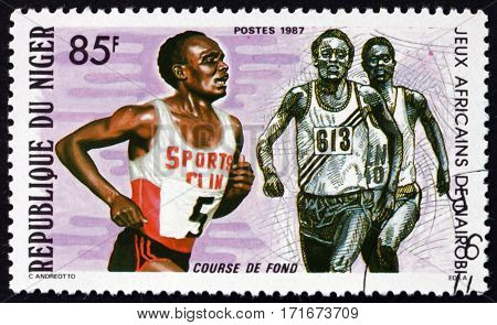 NIGER - CIRCA 1987: a stamp printed in Niger shows Runners African Games Nairobi circa 1987