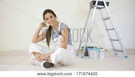 Pretty young woman renovating her home