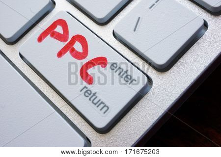 Word PPC (pay per click) written on a keyboard.