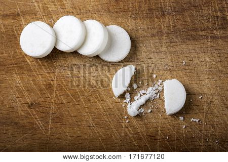 Mint candies on a rustic wooden background