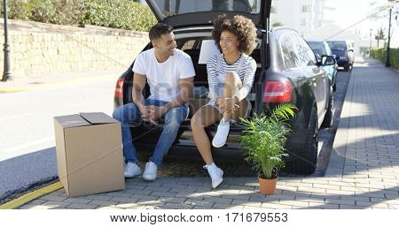 Young couple relaxing while moving house