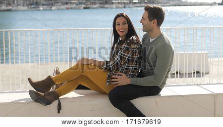 Loving young couple relaxing at the waterfront