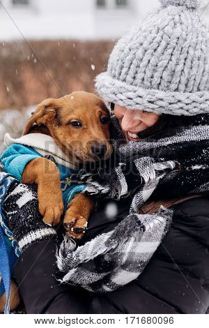 Stylish Hipster Woman Hugging And Caressing Cute Puppy In Snowy Cold Winter Park. Moments Of True Ha
